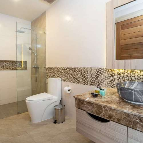 sink-with-top-granite-toilet-and-shower-in-a-house-min