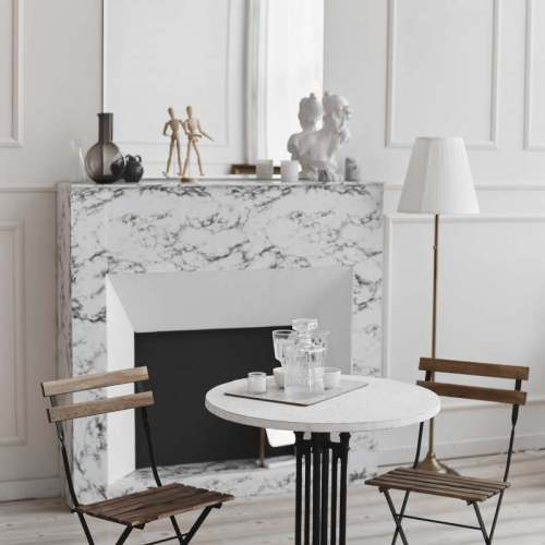 white-living-room-interior-of-retro-table-two-chairs-and-marble-fireplace-min