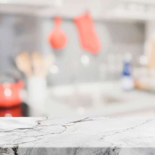 white-stone-table-top-blurred-kitchen-interior-background-can-used-display-montage-your-products-min