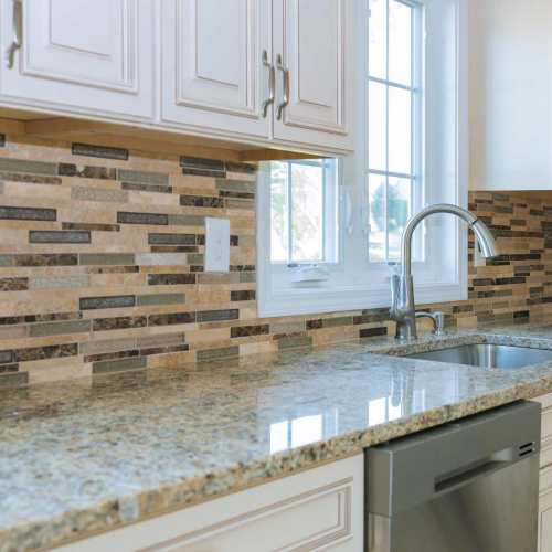 interior-of-modern-kitchen-appliances-on-stove-top-marble-counter-with-kitchen-white-cabinets-min
